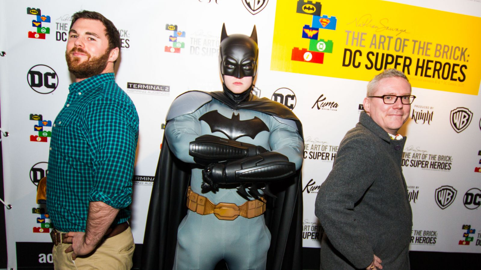 John Corellis & Jonathan Mountford from Made Tourism Travel pictured with Batman at made FAM night to Art Of The Brick